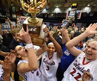The Robert Morris Colonials' Anna Niki Stampolamprou lifts the NEC championship trophy after beating the Bryant Bulldogs at Sewall Center.