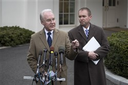 Tom Price, left, Secretary of Health and Human Services, and Mick Mulvaney, director of the Office of Management and Budget, comment on a report Monday by the U.S. Congressional Budget Office that concluded 24 million people would lose health insurance within a decade under a Republican plan to repeal and replace the Affordable Care Act.