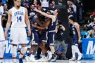 The Mount St. Mary's Mountaineers celebrate after defeating the New Orleans Privateers, 67-66, in an NCAA tournament game Tuesday in Dayton, Ohio.