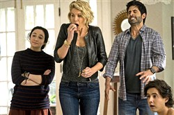 "Career woman Jenna Elfman, second from left, tries to fit in with single dad Stephen Schneider and his children Matreya Scarrwener and Nicholas Coombe in ""Imaginary Mary."""