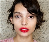 "A model backstage ahead of the Preen by Thornton Bregazzi show during the London Fashion Week wears the ""lollipop"" lipstick look."