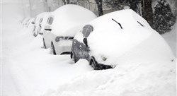 Cars parked on East Green Street in Hazleton, Pa., are buried as heavy snowfall moves through the area leaving more than a foot of snow Tuesday.