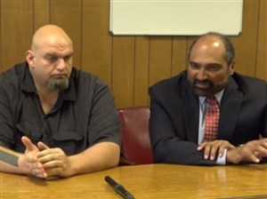 Franco Harris is actively involved in the Pittsburgh community. Here, he is pictured with Braddock Mayor John Fetterman.