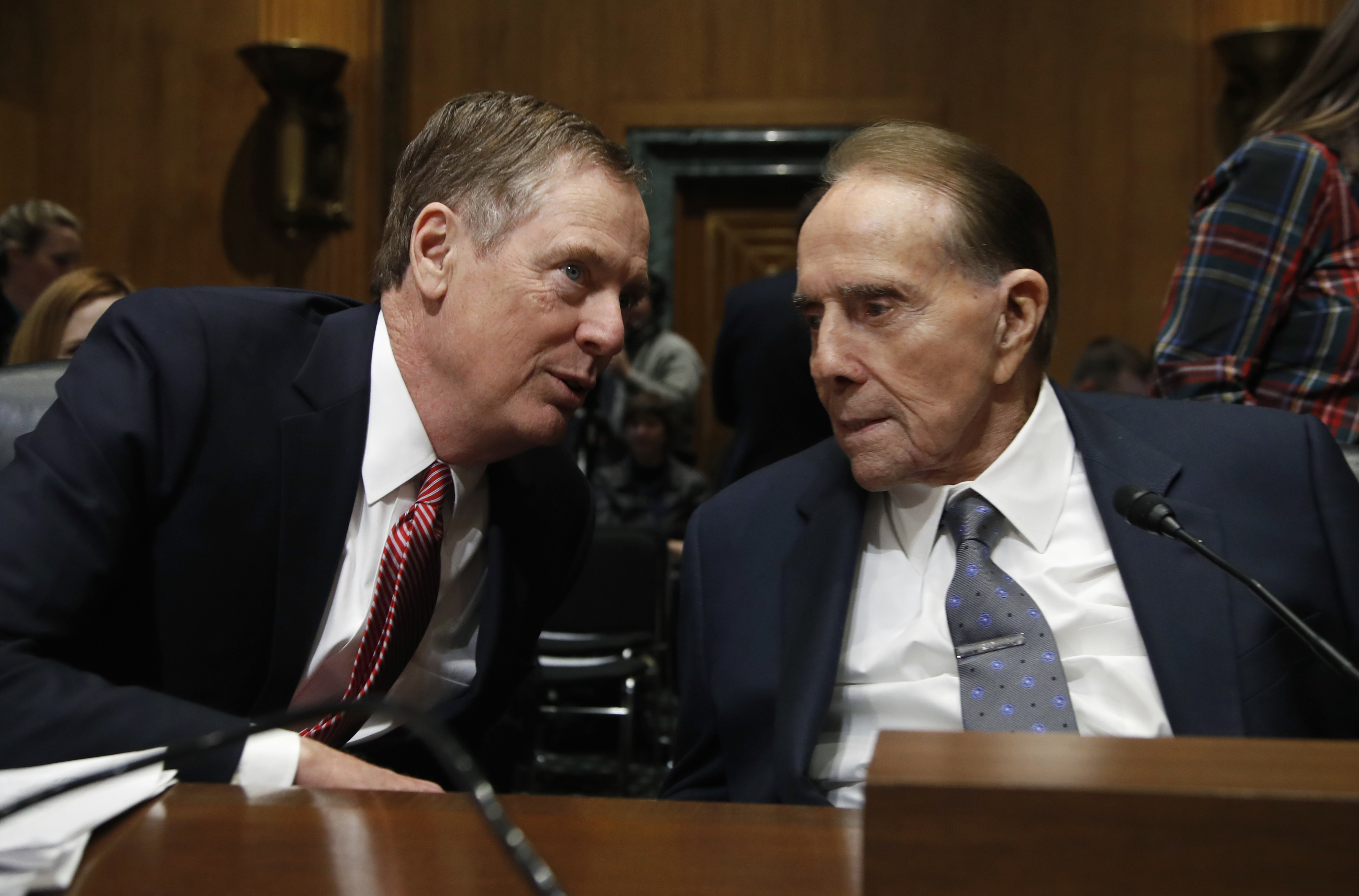 "Trump Trade Representative-1 United States Trade Representative-nominee Robert Lighthizer, left, talks to former Sen Bob Dole, R-Kan., during his confirmation hearing on Capitol Hill in Washington, Tuesday, March 14, 2017. President Donald Trump's pick to represent the country in trade negotiations says the U.S. should have an ""America first trade policy."" (AP Photo/Manuel Balce Ceneta)"