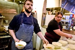 Chef Jesse Barlass, with help from Marisa Cantelli, makes final preparations during a cook off at Smallman Galley in the Strip District on Monday. Mr. Barlass was one of eight candidates auditioning for one of four openings at the restaurant incubator.