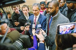Former New York Jets cornerback Darrelle Revis and his attorney Robert Del Greco Jr., center, address the media Wednesday inside City Court after Mr. Revis' preliminary hearing.