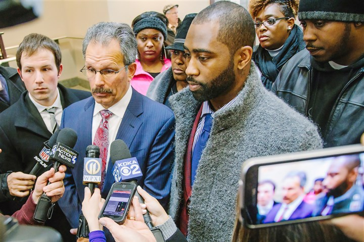 20170315arDarrelleRevis05-1 Darrelle Revis and his attorney Robert Del Greco Jr., speak to the media outside City Courty on March 15, 2017. (Andrew Rush/Post-Gazette)