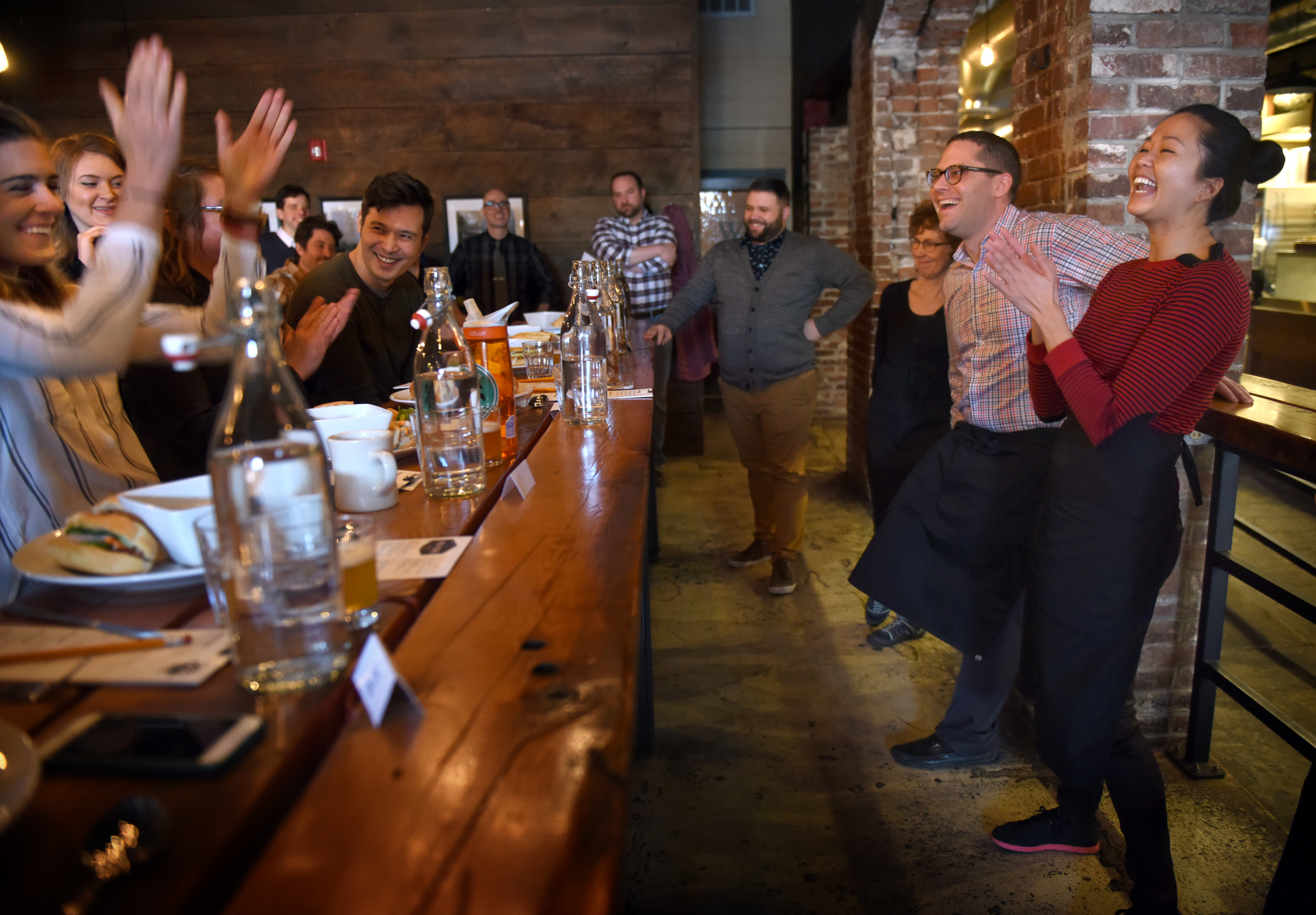 20170213smCookOff001 Executive chef Hoa Le, right, jokes with judges during a cook off at Smallman Galley in the Strip District on Monday.