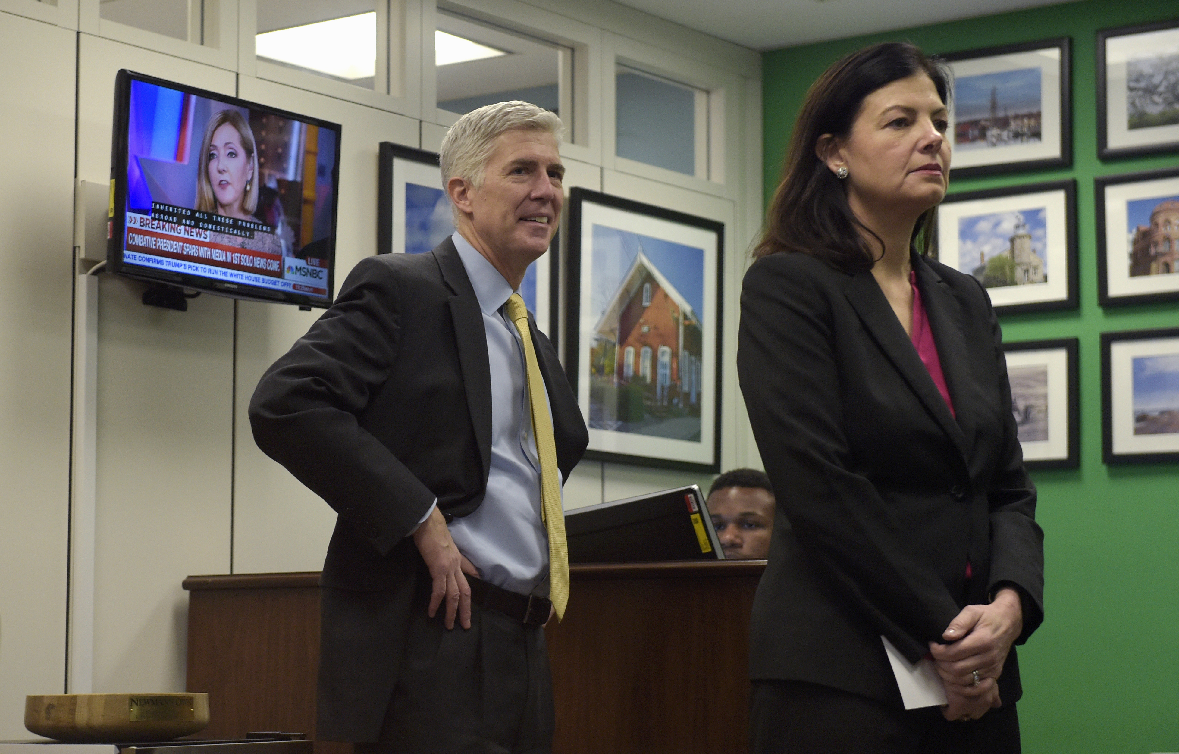 Supreme Court Gorsuch Environment FILE - In this Feb. 16, 2017 file photo, Supreme Court Justice nominee Neil Gorsuch and former New Hampshire Sen. Kelly Ayotte wait for a meeting with Sen. Chris Murphy, D-Conn. on Capitol Hill in Washington. By the time a lawsuit over pollution from a nuclear weapons plant had reached Judge Neil Gorsuch, it had crawled through the courts for more than two decades, outliving some of the landowners who said the contamination destroyed their property values. The pace of the litigation didn't sit well with Gorsuch, a judge for the Denver-based 10th U.S. Circuit Court of Appeals, and now a nominee for the U.S. Supreme Court. (AP Photo/Susan Walsh, File)