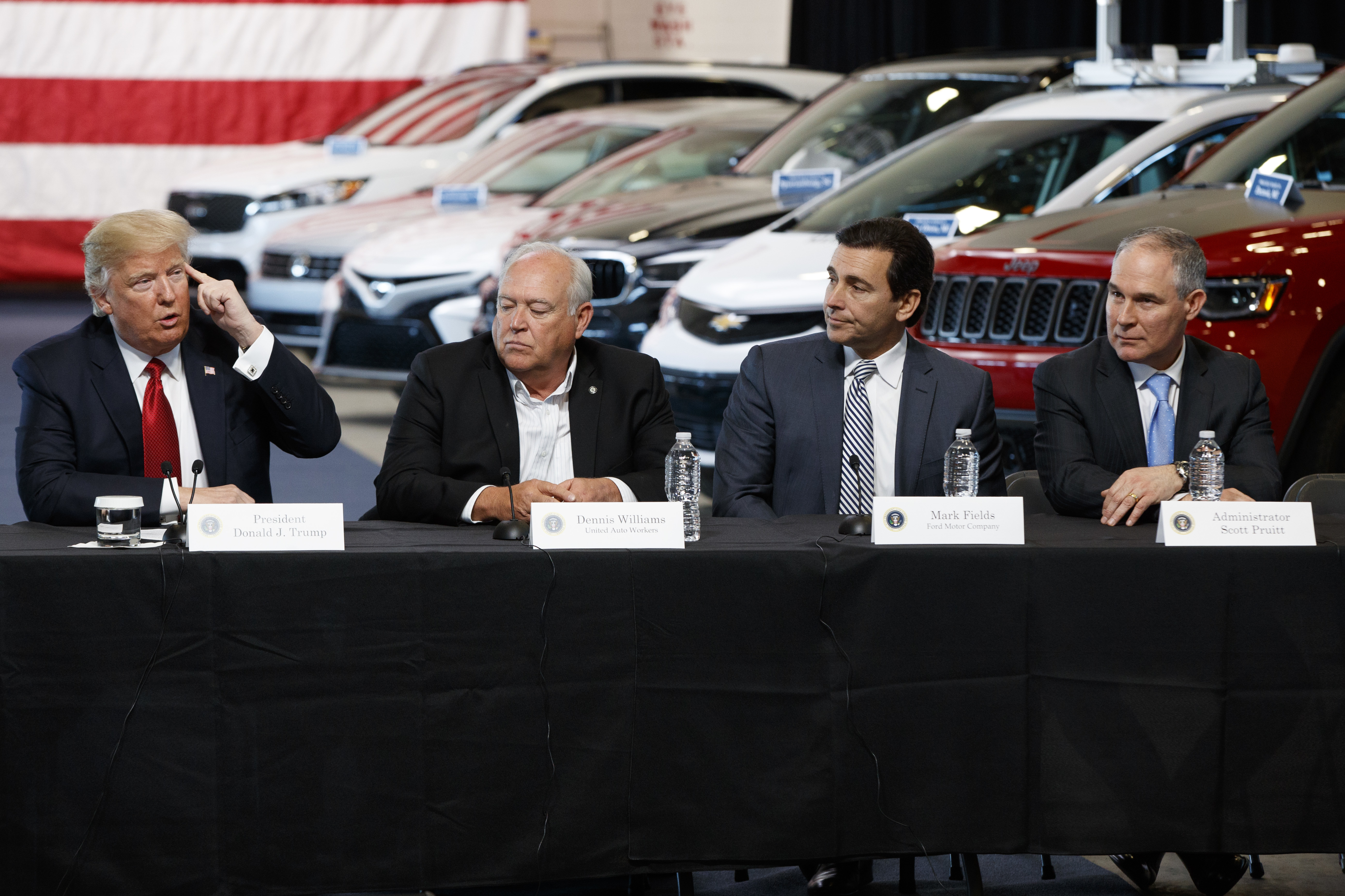 Trump President Donald Trump speaks during a roundtable at the American Center of Mobility, Wednesday, March 15, 2017, in Ypsilanti Township, Mich. From left are, Trump, UAW president Dennis Williams, Ford CEO Mark Fields, and EPA administrator Scott Pruitt. (AP Photo/Evan Vucci)