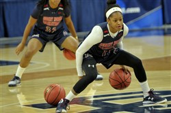 Robert Morris' Janee Brown works on a ball-handling drill Thursday at Purcell Pavillion in Notre Dame, Ind.