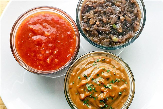 Clockwise from left: Spicy mango barbecue sauce, red wine sauce and peanut sauce.