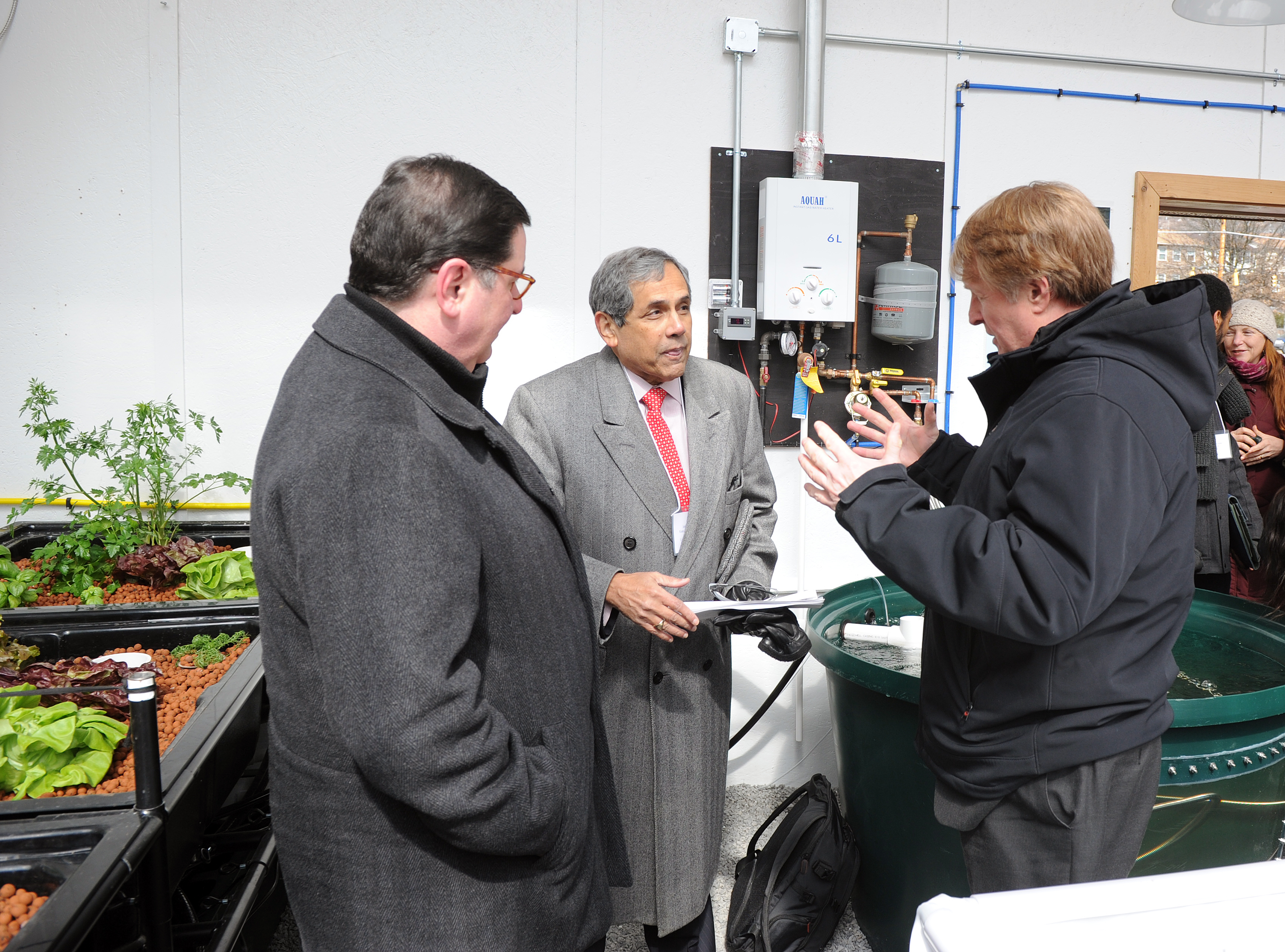 20170316ng-Greenhouse2-1 University of Pittsburgh professor John Camillus speaks Thursday with Mayor Bill Peduto and County Executive Rich Fitzgerald about the solar-powered bioshelter on Fleury Way in Homewood.
