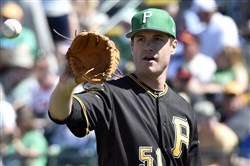 Pirates pitcher Tyler Webb gets the ball during a spring training game against the Orioles on March 17 at LECOM Park in Bradenton, Fla.