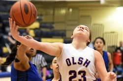 OLSH's Jocelyn Nagy (23) is fouled by Leechburg in a PIAA girls basketball playoff game at Canon-McMillan.