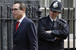 U.S. Secretary of the Treasury Steven Mnuchin walks past a police officer at Downing Street to meet Britain's Chancellor Philip Hammond in London on Thursday.