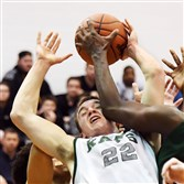 Pine-Richland's Phil Jurkovec is fouled by Allderdice's Shaun Morris in the second half Thursday in a PIAA Class 6A playoff game at Baldwin High School.