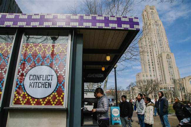 People wait in line during lunch hour at Conflict Kitchen in Oakland on Friday.