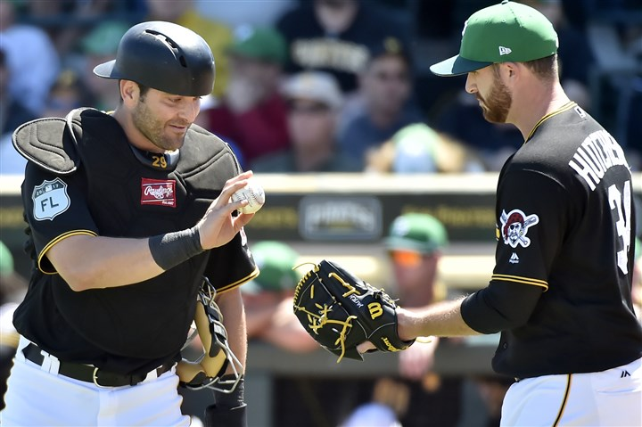 20170317mfbucssports12-6 Pirates catcher Franciso Cervelli gives the ball back to starting pitcher Drew Hutchison as they take on the Baltimore Orioles in a spring-training game Friday at LECOM Park in Bradenton, Fla.