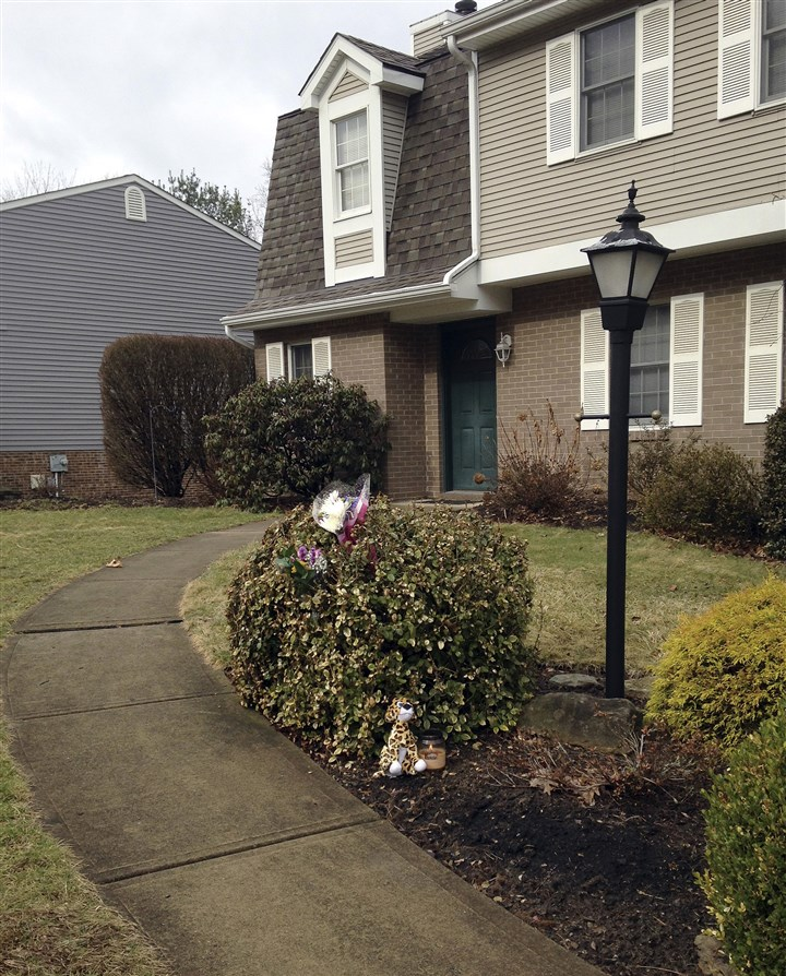 9o700lvk-6 A stuffed animal and flowers sit outside the Schlemmer family home in McCandless in April 2014.