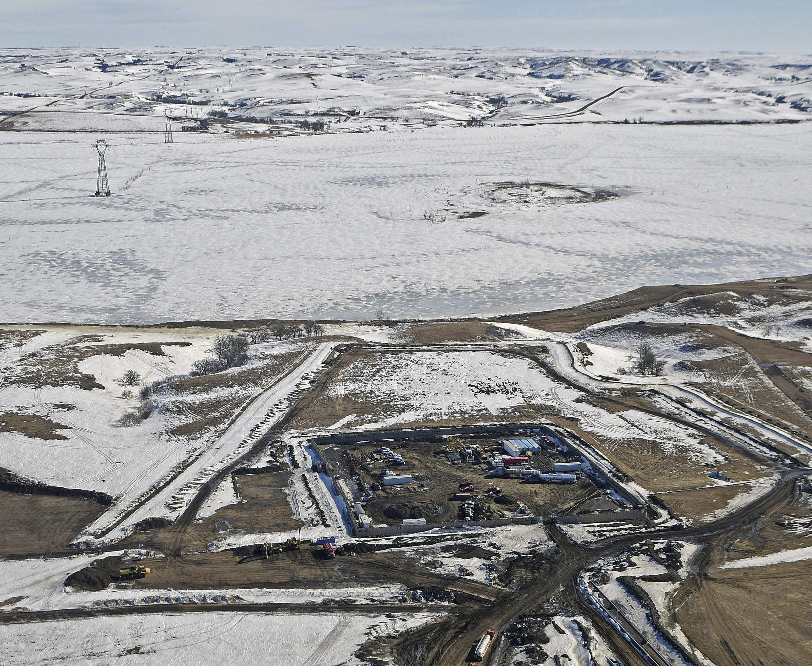 Oil Pipeline-1 This Feb. 13, 2017, aerial file photo, shows a site where the final phase of the Dakota Access pipeline is taking place with boring equipment routing the pipeline underground and across Lake Oahe to connect with the existing pipeline in Emmons County near Cannon Ball, N.D.