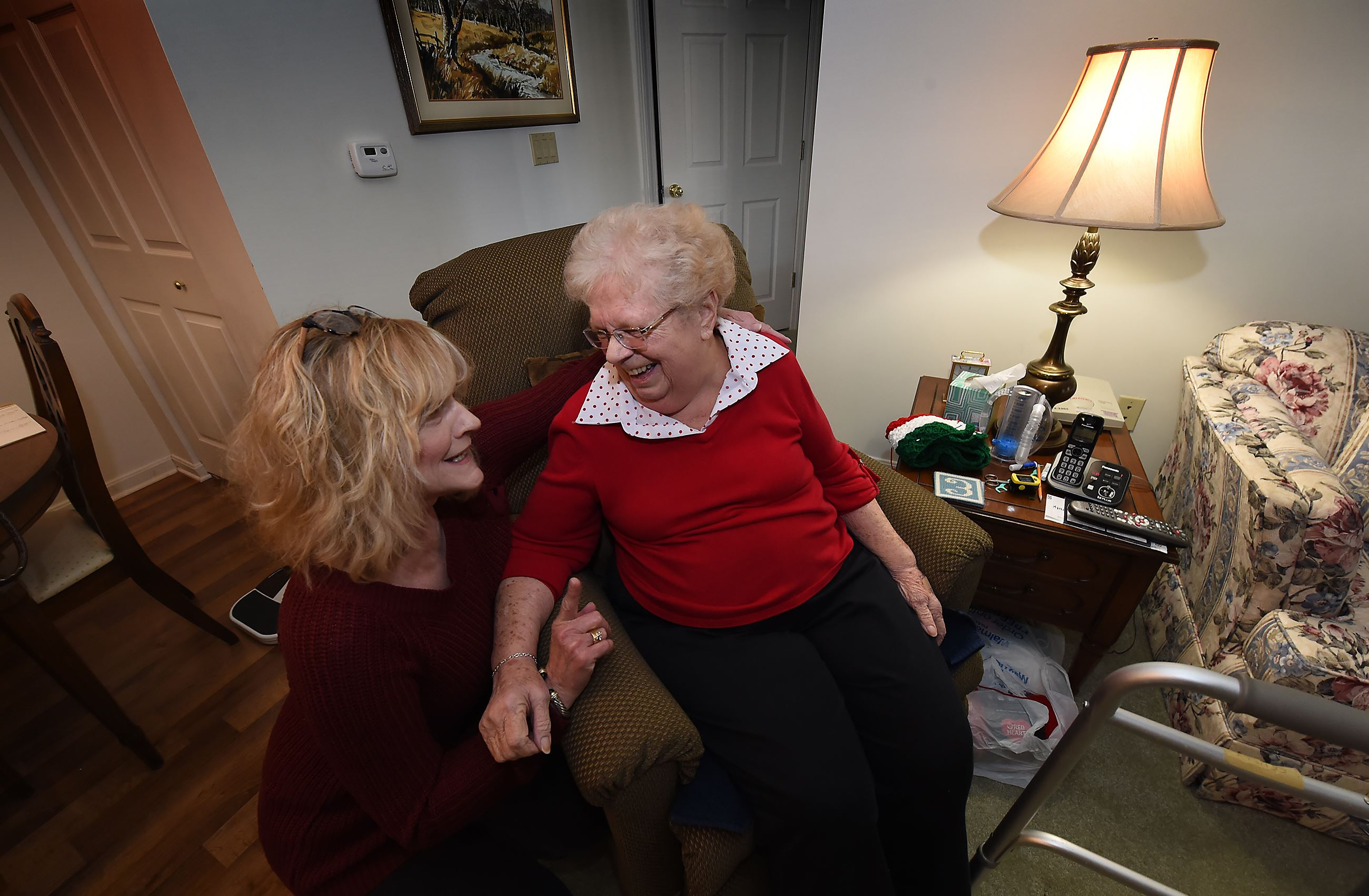20170316pdHealthCare02-1 Cindy McDonald, an aide with Sunny Days In-Home Care, shares a laugh with Betty Erdely in Ms. Erdely's Bethel Park home.