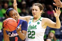 Robert Morris' Shakema Dashiell looks to pass around Notre Dame's Erin Boley during the teams' first-round NCAA tournament game in March.