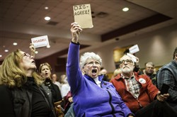 Audience members show their disapproval during a town hall event hosted by Republican U.S. Rep. Scott Perry at a school in Red Lion, York County on Saturday.
