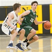Nolan Rausch, right, came up big for Pine-Richland with 18 points Saturday in a Class 6A quarterfinal win against Butler. He brings the ball up against Luke Michalek.