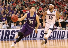 Bryant McIntosh of the Northwestern Wildcats is pursued by Josh Perkins of the Gonzaga Bulldogs during the second round of the NCAA Men's Basketball Tournament Saturday in Salt Lake City, Utah.