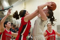 Isabella Burrelli, left, of Neshannock blocks a shot by West Shamokin's Katie Glover in a PIAA Class 3A quarterfinal.