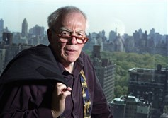 Jimmy Breslin takes a photo from his New York apartment in 2004.