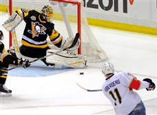 Penguins goalie Marc-Andre Fleury blocks a shot by the Florida Panthers' Jonathan Huberdeau.