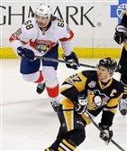 Florida Panthers' Jaromir Jagr (68) and Pittsburgh Penguins' Sidney Crosby (87) skate during the first period.