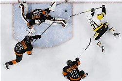 Evgeni Malkin (71) cannot get a shot past Philadelphia's Steve Mason as Travis Konecny (11) and Nick Schultz (55) defend March 15 in Philadelphia.