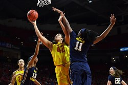 Maryland center Brionna Jones (42) shoots between West Virginia forwards Kristina King (left) and Teana Muldrow in the first half of the Terrapins' blowout win in the second round of the NCAA women's tournament Sunday in College Park, Md.
