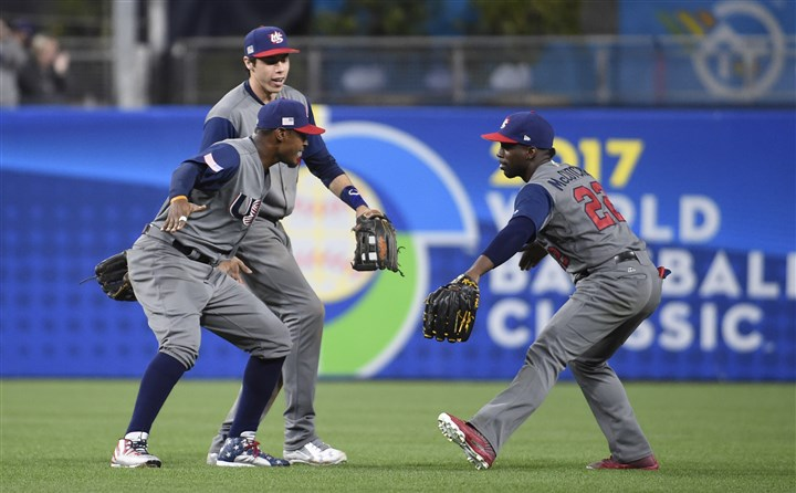 World Baseball Classic - Pool F - Game 6 - United States v Dominican Republic-2 Adam Jones, Christian Yelich and Andrew McCutchen celebrate after beating the Dominican Republic 6-3 in the World Baseball Classic quarterfinal in San Diego.