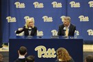 Pitt chancellor Patrick Gallagher looks on as Heather Lyke answers a question during her introductory press conference Monday. Lyke was named Pitt's new athletic director.