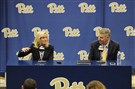 Pitt chancellor Patrick Gallagher looks on as Heather Lyke answers a question during her introductory press conference on Monday, March 20, 2017. Ms. Lyke was named Pitt's new athletic director.