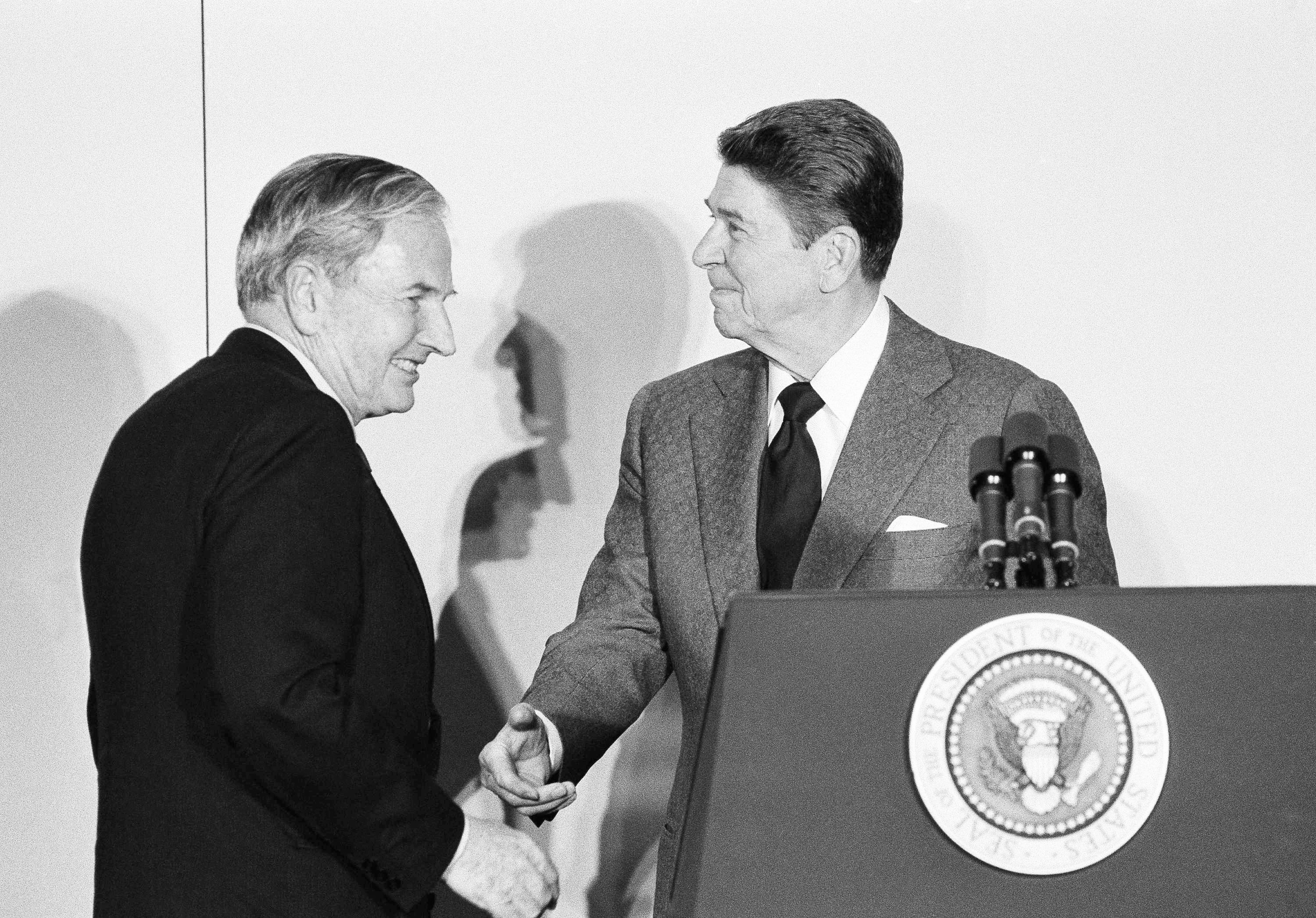 Obit David Rockefeller FILE - In this May 8, 1984 file photo, David Rockefeller, left, chairman of the Council Americas, shakes hands with President Ronald Reagan at the State Department in Washington. David Rockefeller, the billionaire philanthropist who was the last of his generation in the famously philanthropic Rockefeller family died, Monday, March 20, 2017, according to a family spokesman. (AP Photo/Ira Schwarz, File)