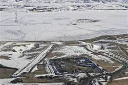 This Feb. 13, 2017, aerial file photo, shows a site where the final phase of the Dakota Access pipeline is taking place with boring equipment routing the pipeline underground and across Lake Oahe to connect with the existing pipeline in Emmons County near Cannon Ball, N.D. Federal Judge James Boasberg on Tuesday, March 14 denied a request by the Standing Rock and Cheyenne River Sioux to stop oil from flowing while they appeal his earlier decision allowing pipeline construction to finish.