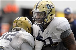 Pitt defensive linemen Rori Blair (92), left, and Keyshon Camp work during a drill Tuesday morning at spring practice on the South Side.