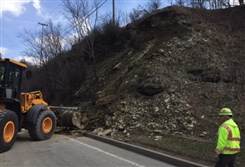 PennDOT workers clean up debris from a landslide on Route 22 in Monroeville on Tuesday, March 21, 2017.