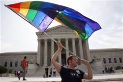 John Becker of Silver Spring, Md., waves a rainbow flag in support of gay marriage outside of the Supreme Court in Washington in June 2015.