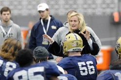 Pitt's new athletic director Heather Lyke speaks to the Panthers football team Tuesday on the South Side.