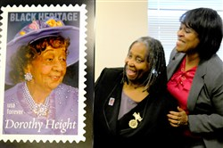 Delores Dupree, left, President of Rankin/Mon Valley NCNW, and Penny Graves, Postmaster of Braddock, help unveil the Dorothy Height Forever stamp in the special dedication at the Rankin Christian Center in Rankin on Tuesday.