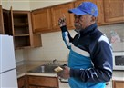 Penn Plaza resident Franklin Means points out water damage to his kitchen in his first-floor studio apartment in the East Liberty complex.