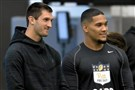 Quarterback Nate Peterman and running back James Conner watch teammates participate in Pitt football's pro day Wednesday at the UPMC Rooney Sports Complex on the South Side.