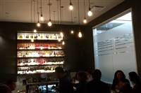 The bar area at the newly opened Talia Cucina & Rosticceria in the old Alcoa Building, Downtown.