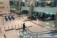 Airport staff gather near a security checkpoint at Cairo International Airport on Tuesda.